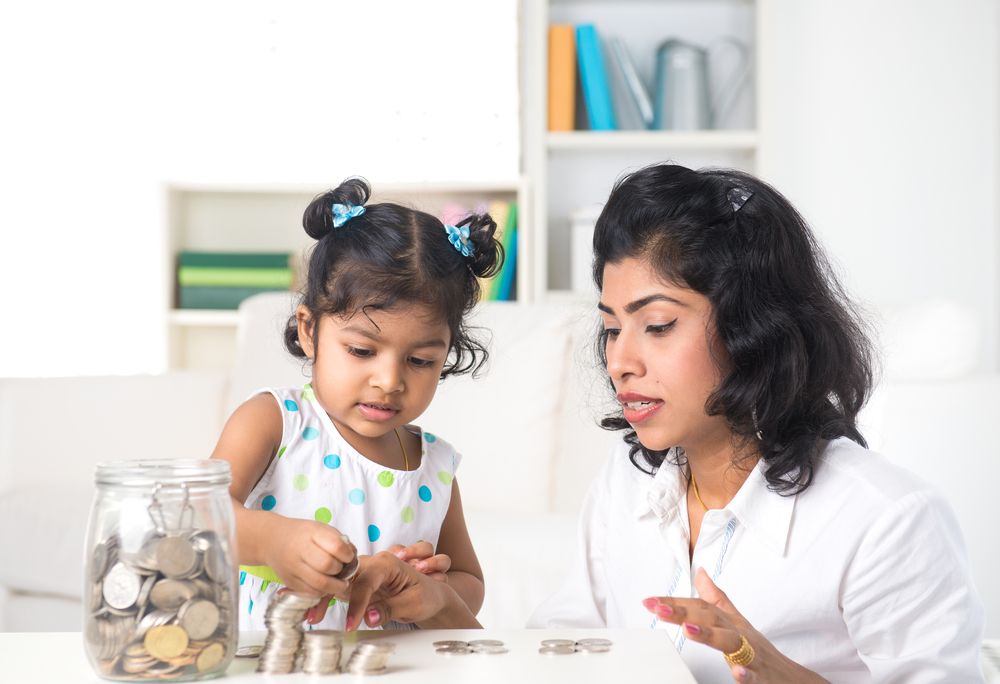 Mother teaching daughter to become financially independent